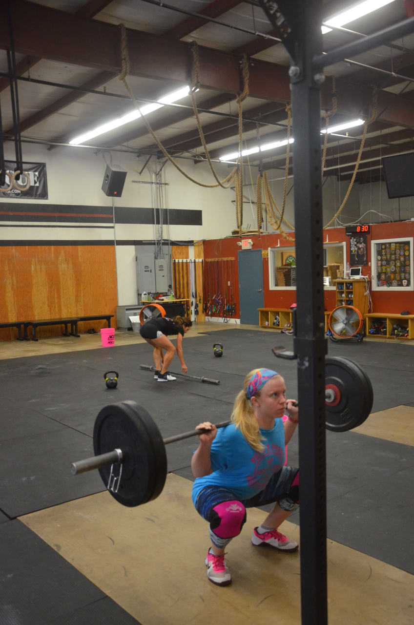 Sydney showing great form on her back squats.