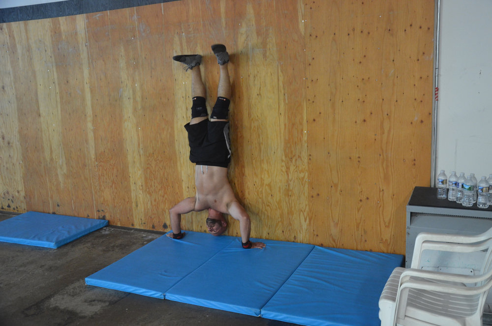Brian G. not letting a few handstand push-ups slow him down.