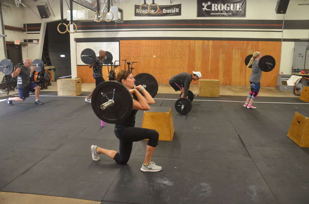 Sharon and the 8am working through their minute of lunges.