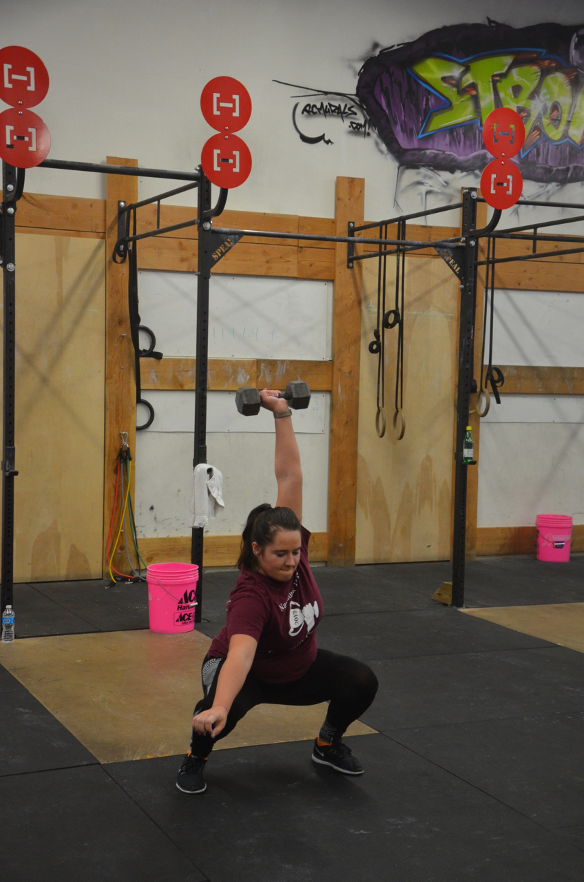 Michaele looking strong during her dumbbell squat snatches.