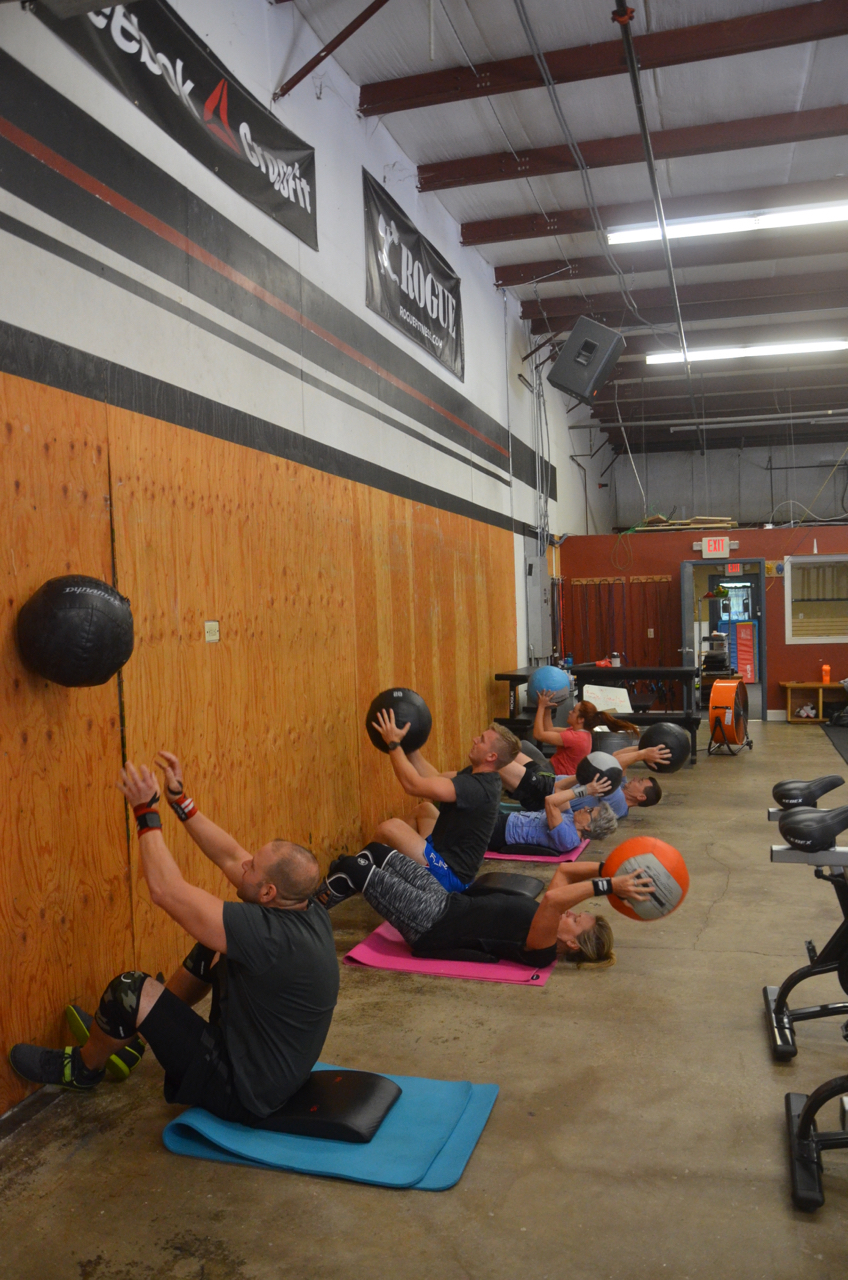 Rob B and the 9:30am class working through their wall-ball sit-ups.