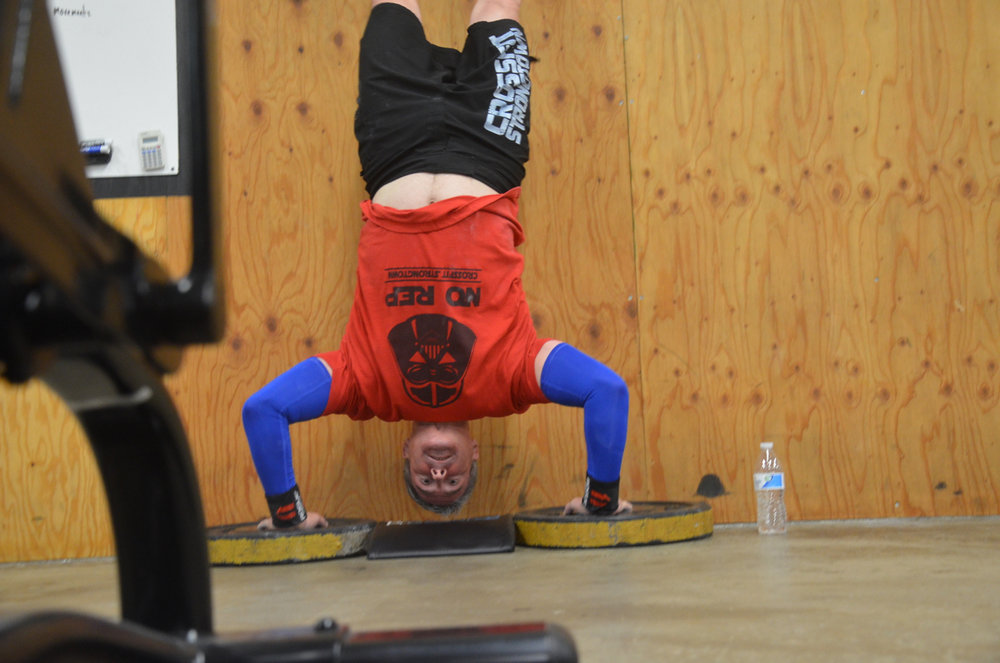 Pat loves his handstand push-ups