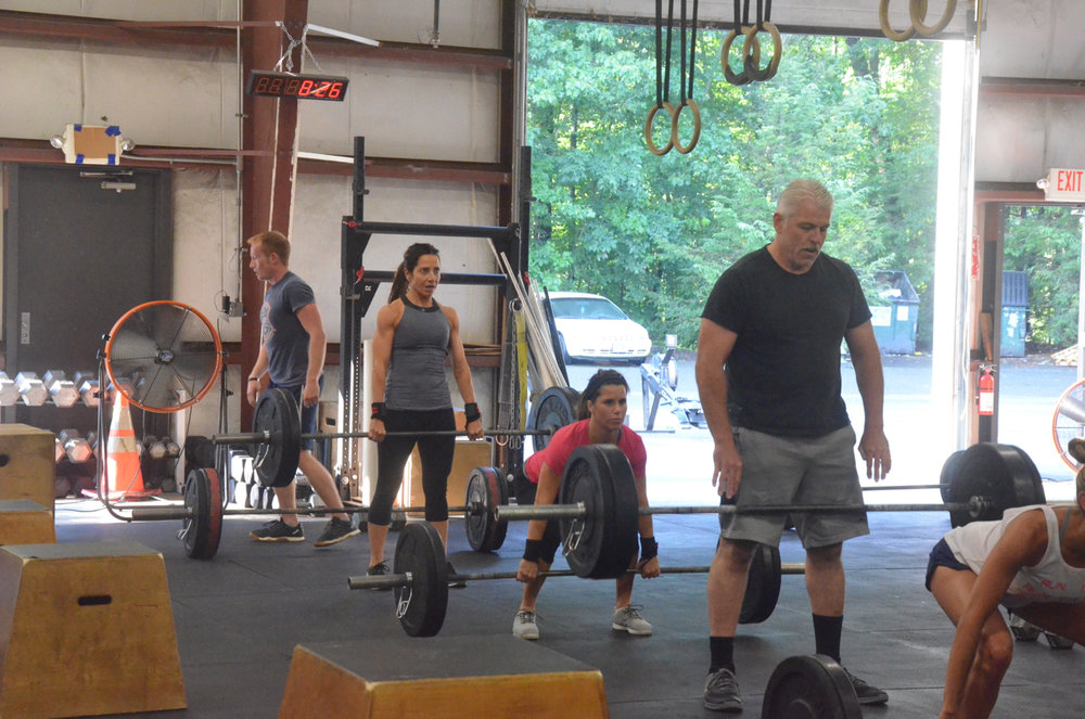 Carl and the 8:00am class during their 7 Minutes of Deadlifts & Box Jumps.