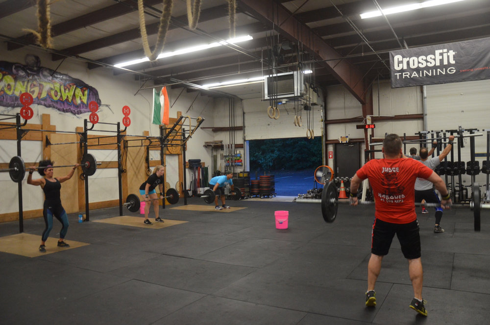 The 6am at the beginning of their 50 power snatch for time.