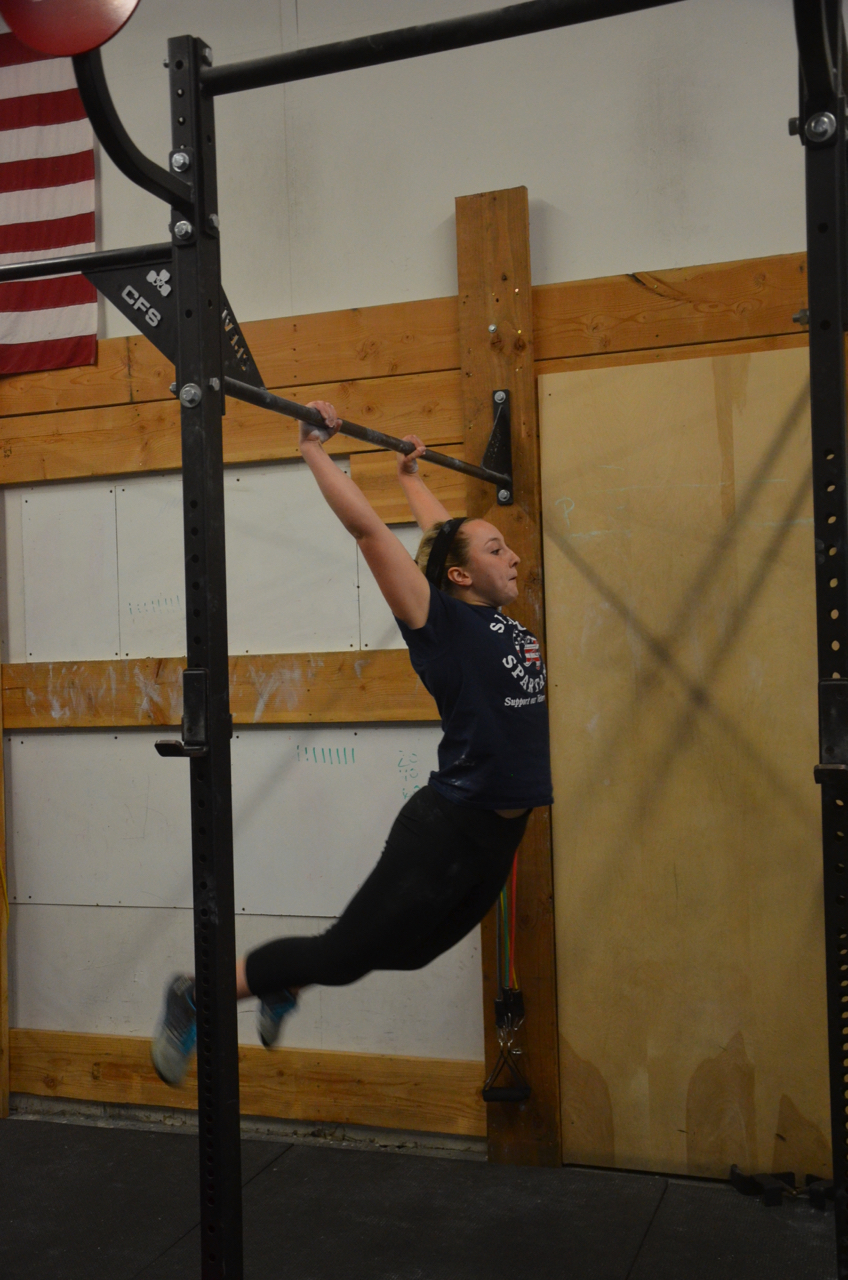 Annie showing a great kip on her pull-ups.