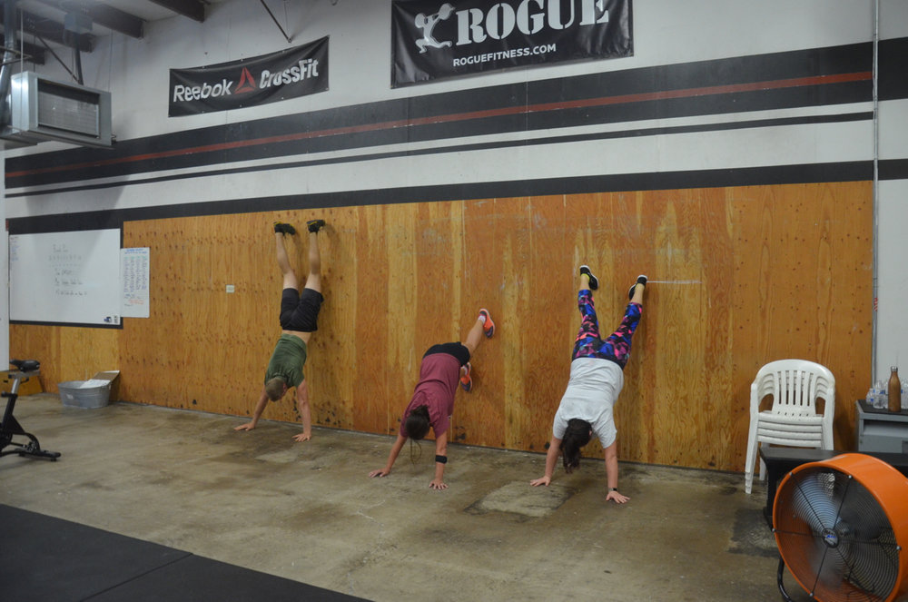 Tanner, Candice, and Michele working through their wall-climbs.