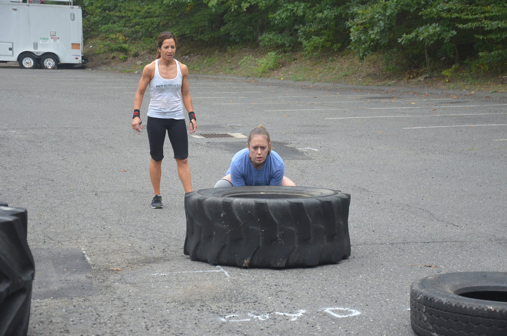 Courtney getting set for her tire flip.