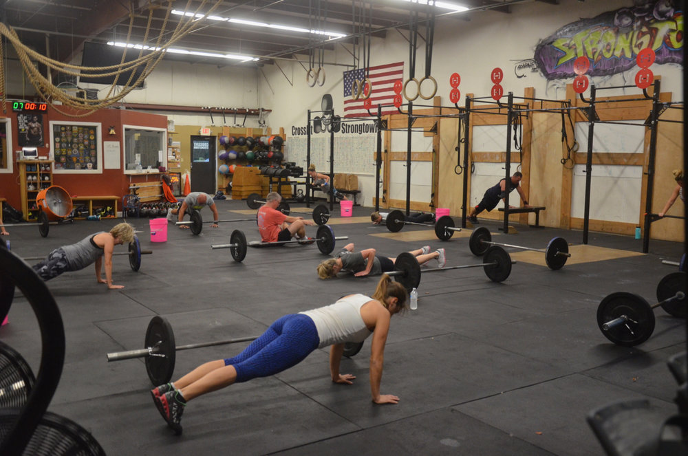 The 5pm class working through their push-ups.