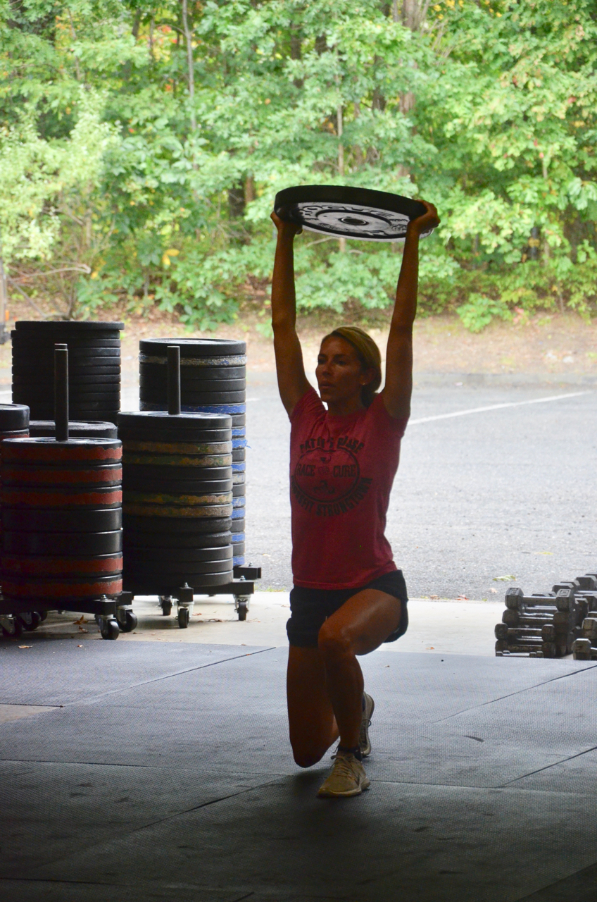 Danielle showing a solid lock out on the overhead walking lunges.