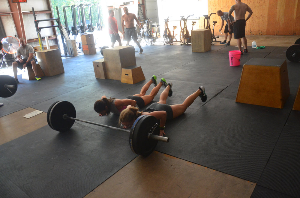 Holly and Lu flying through their bar facing burpees.