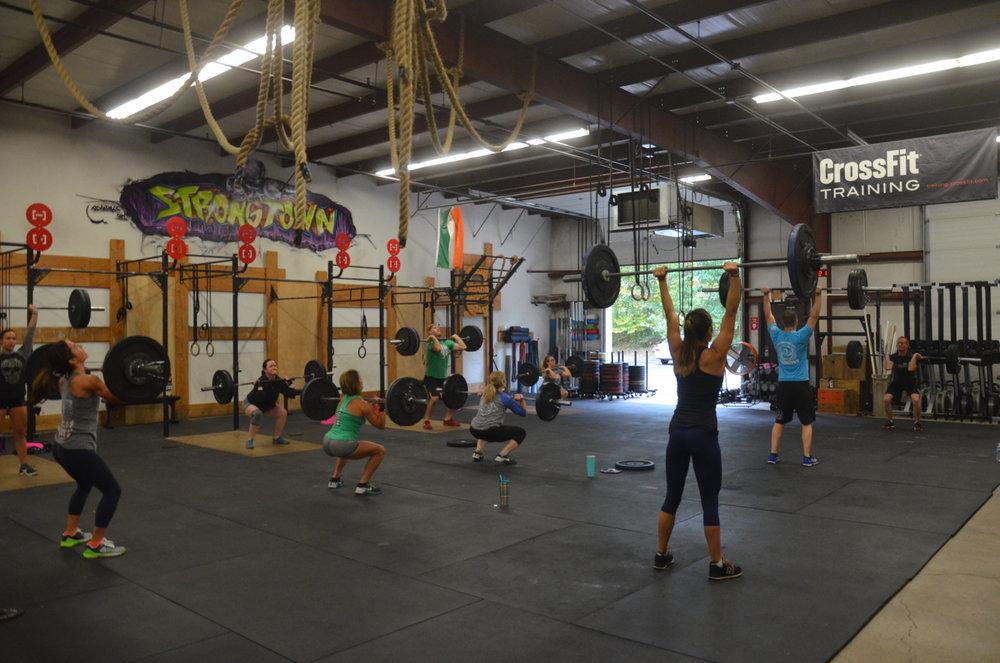 Saturday's 9am class starting their Thruster - Run medley.