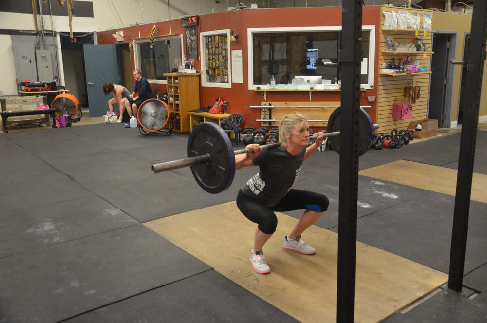 Hope at the bottom of her 5 second tempo back squat.