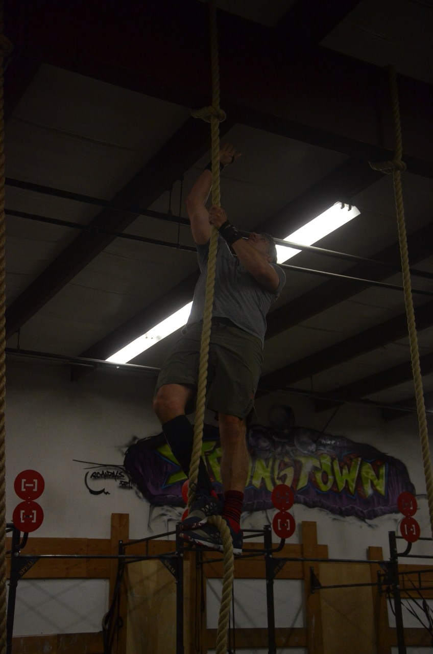 Bill making sure he makes contact at the top of the rope climb.