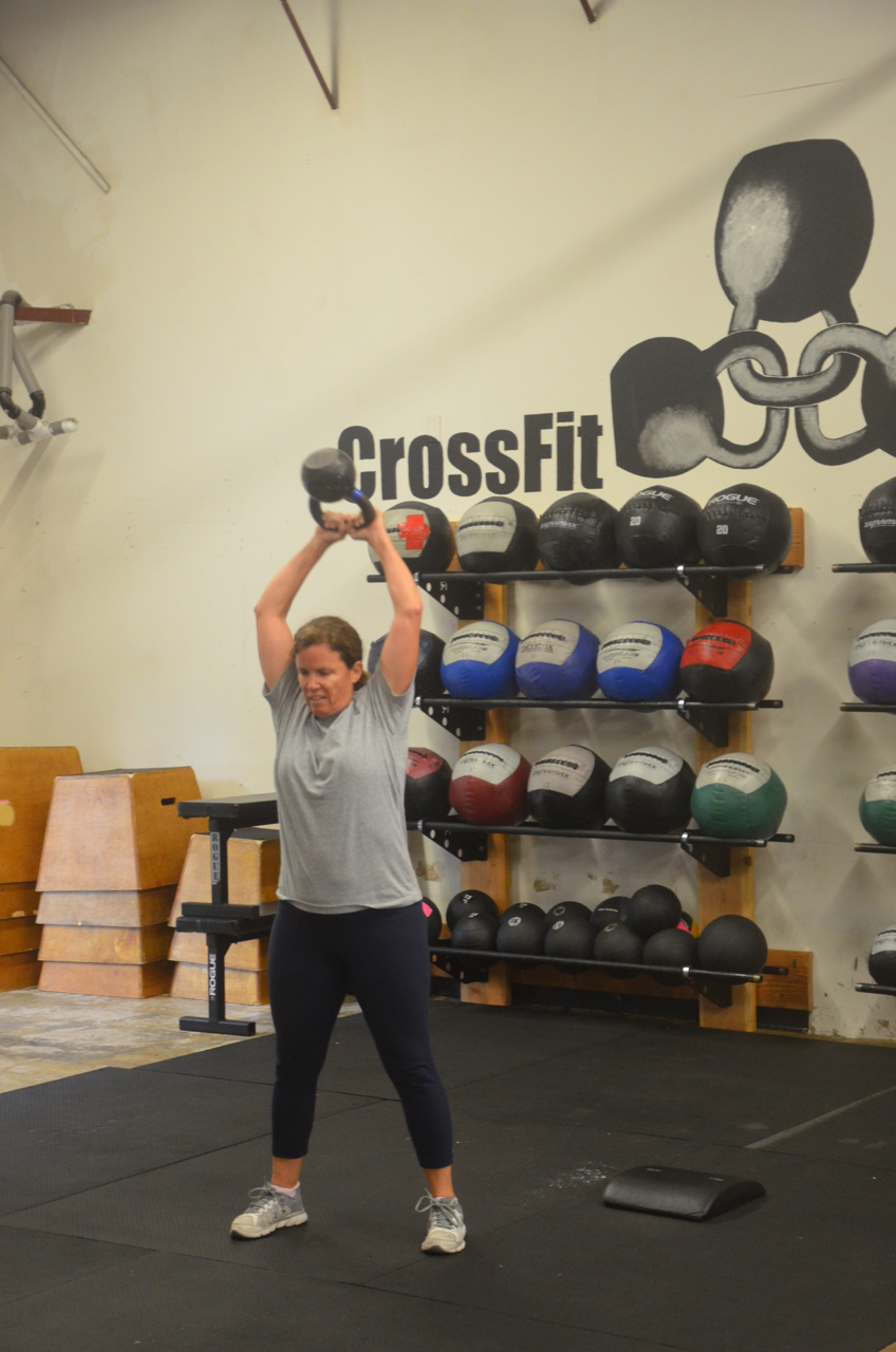 Susie Jones showing a good lock out on her kettlebell swings