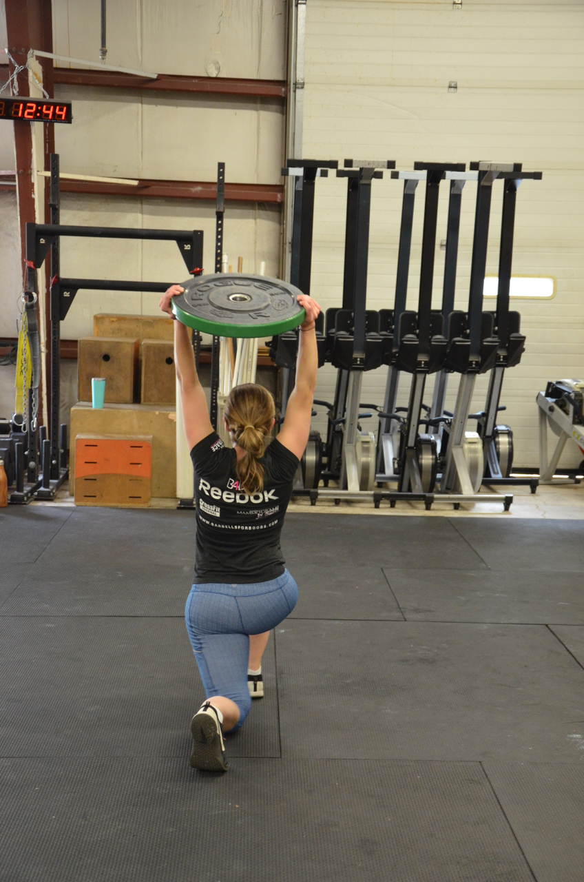 Sophia showing great form on her overhead lunges.