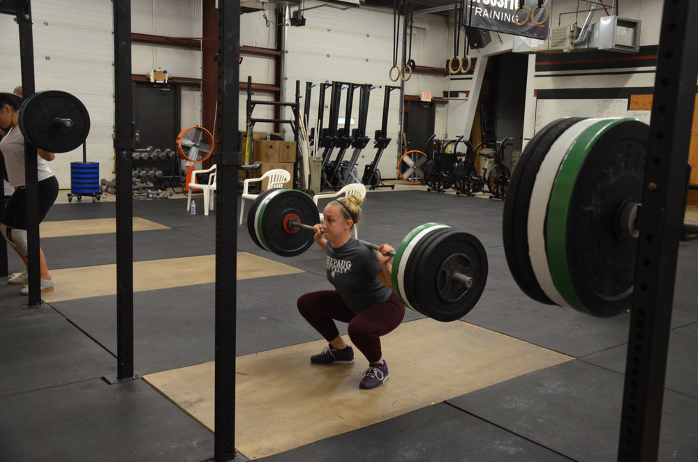 Annie showing great form on her back squat.