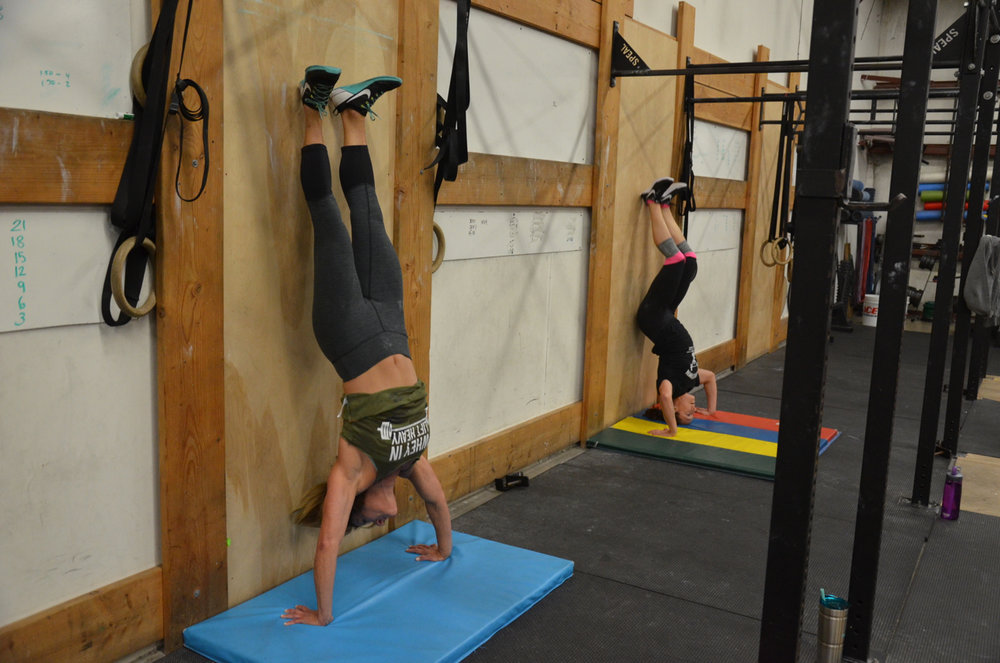 Ang and Kelly looking strong on their handstand push-ups
