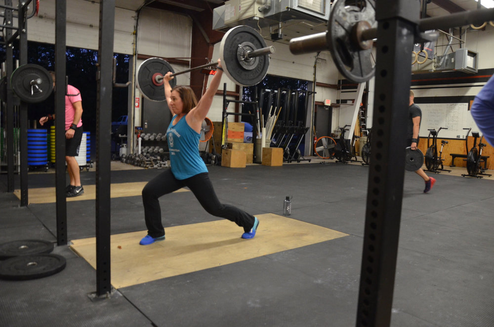 Rachel showing a solid catch in her rear neck split jerk.