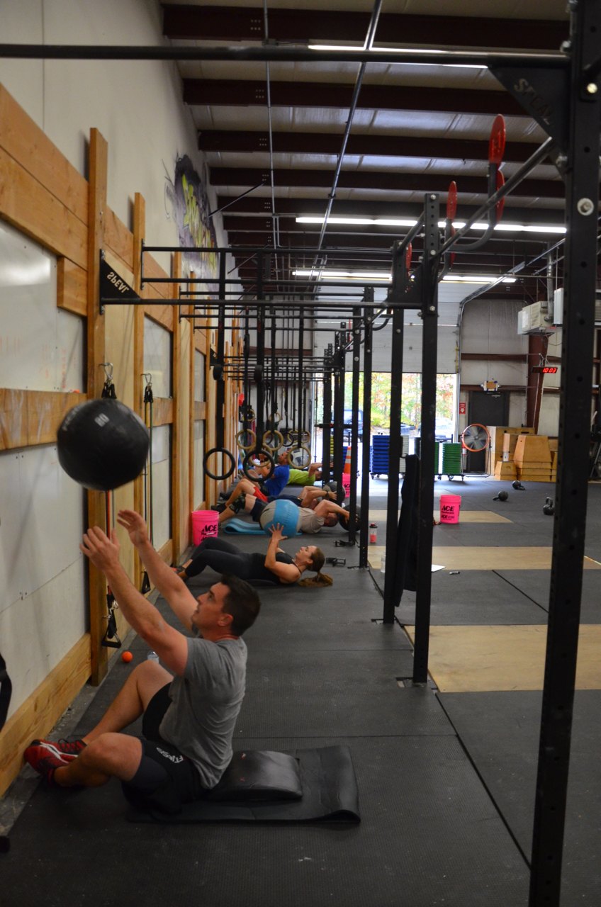 Brian and the 9:30am class during their wall-ball sit-ups.