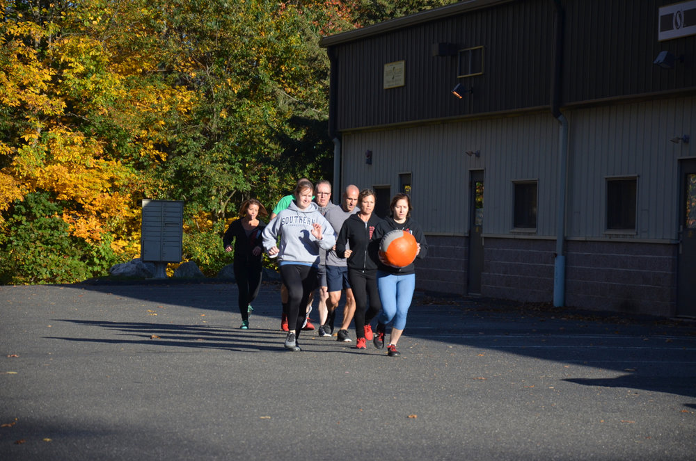 Friday's 4pm class warming up with a 400m med-ball Indian run.