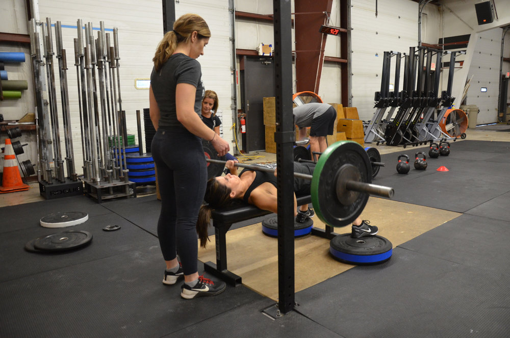 Sophia spotting Jen on the Bench Press.