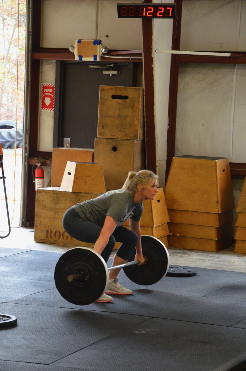 Hope coming off the ground during the three position snatch.