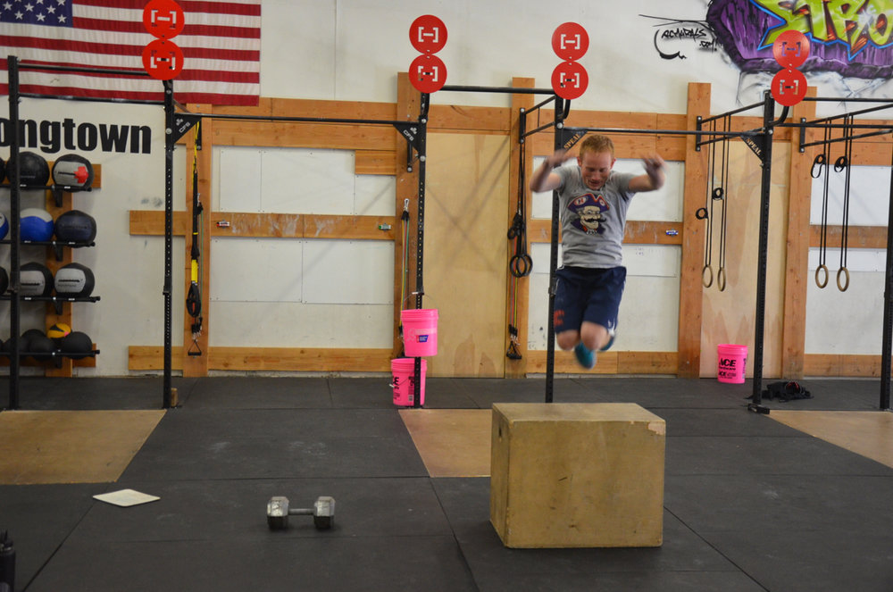 Chris actually jumping over the box during his box jump overs.