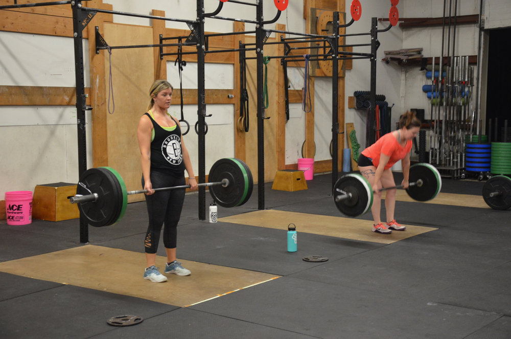 Sarah and Taylor working through their deadlifts.