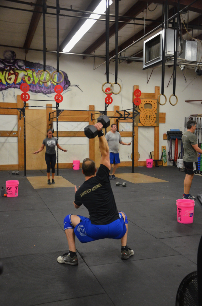 Funk during the DB overhead squats.