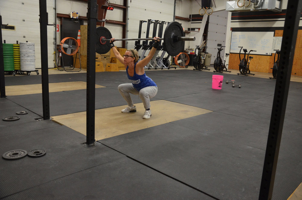 Paula at the bottom of her overhead squats.