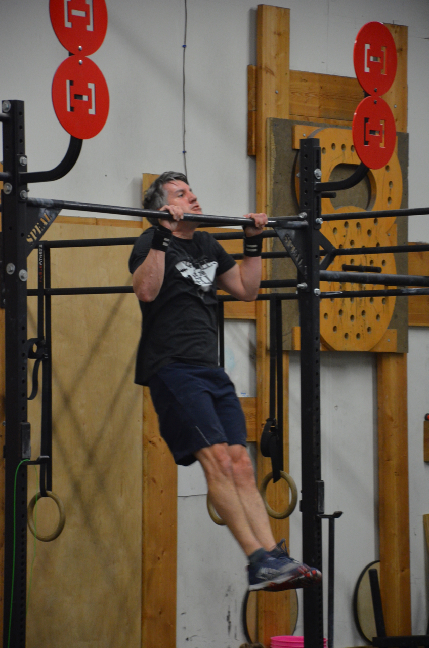 Bill making sure to get his chin over the bar for his strict pull-ups.