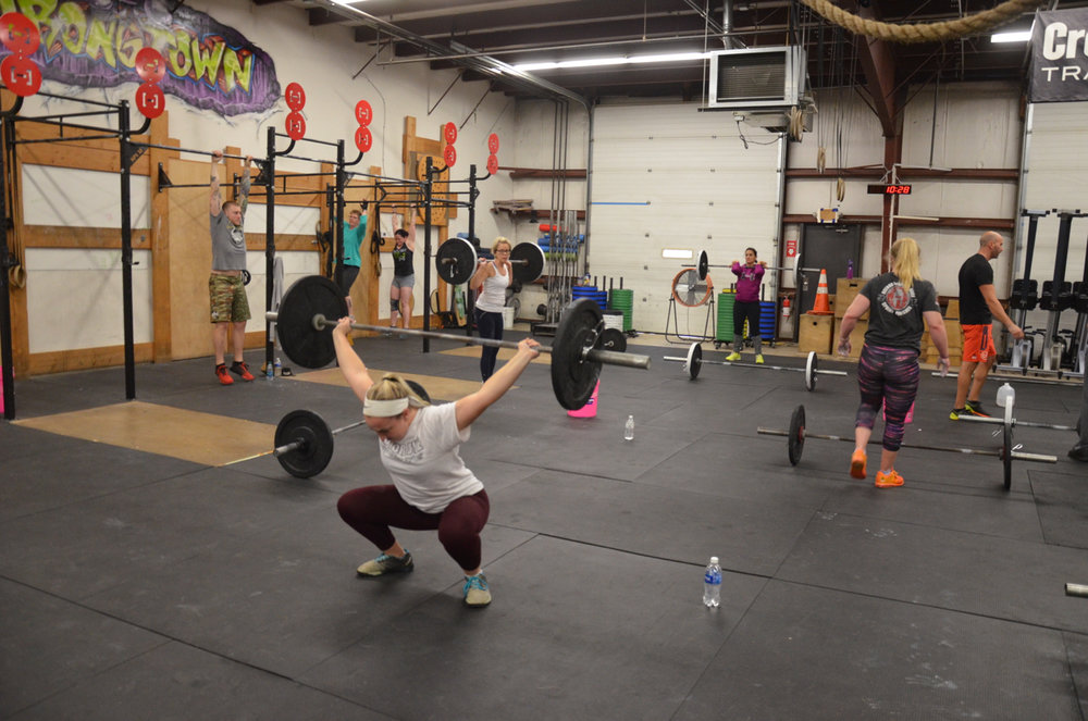 Annie showing good depth on her overhead squats.