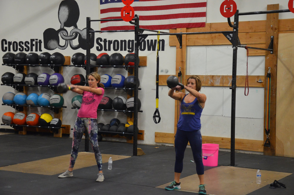 Angela and Danielle working through the Russian Kettlebell swings.