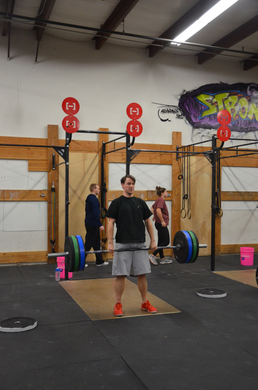 Rich standing tall at the top of the deadlift.