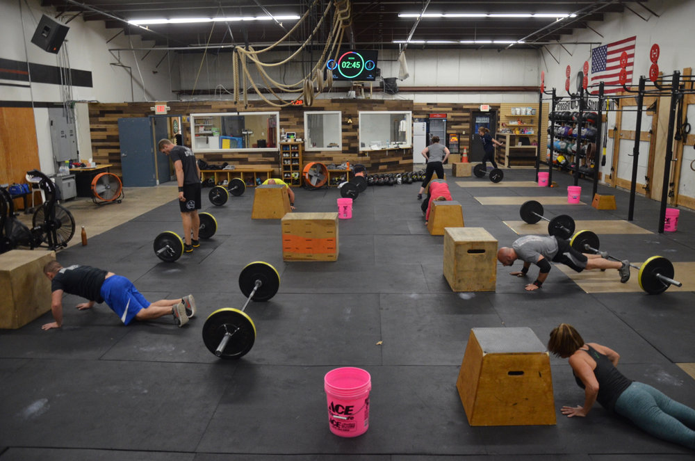 The 4pm class making sure to get chest to deck with their burpees.