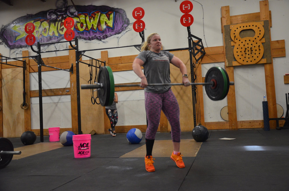 Sydney during her hang power cleans on Saturday's workout.
