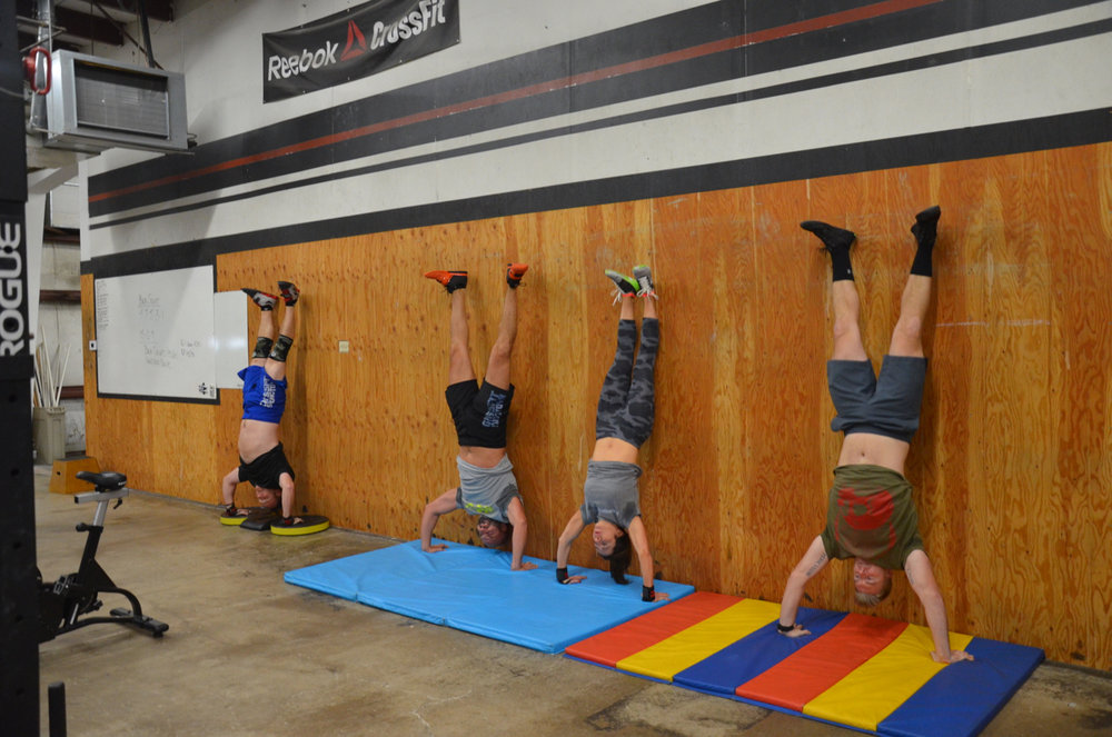BVN, Shady, Holly, and Scotty during their set of 15 handstand push-ups.