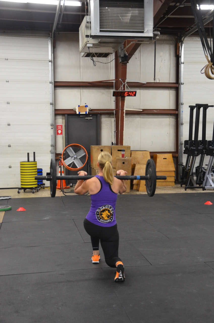 Ro working through the Axle bar walking lunges.