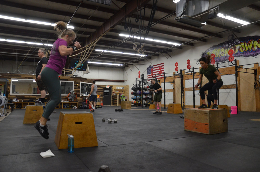 Heidi and Holly hitting the box jumps during Friday's 6am class.