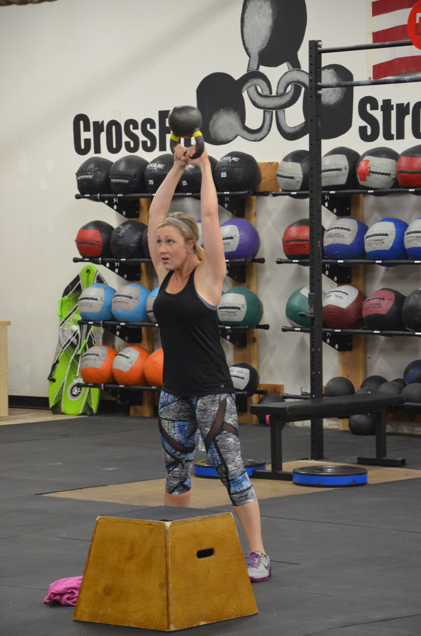 Stacy showing a great lock out on her Kettlebell swings.