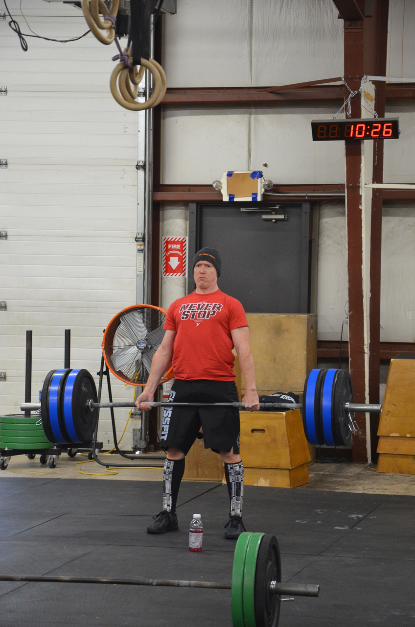 Scott making sure to stand tall at the top of his deadlift.