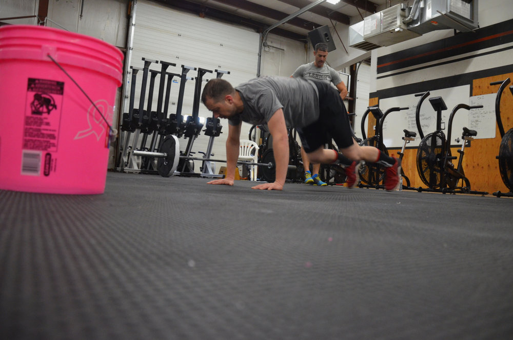 Coach Dan dropping down into his burpees.