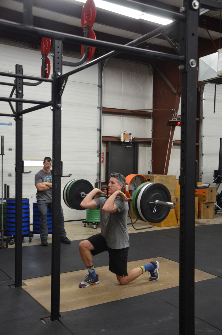 Bill showing great elbows on his front rack barbell lunges.