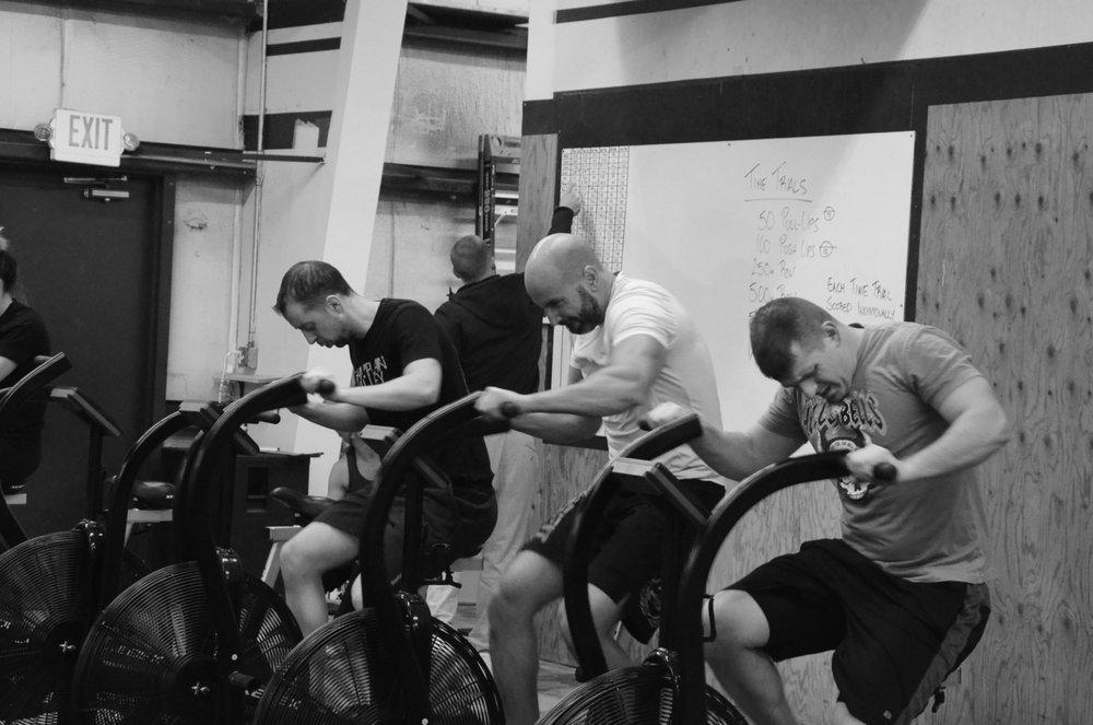 Garrett, Shady, and Dan attacking the 500m sprint on the Xebex bike.