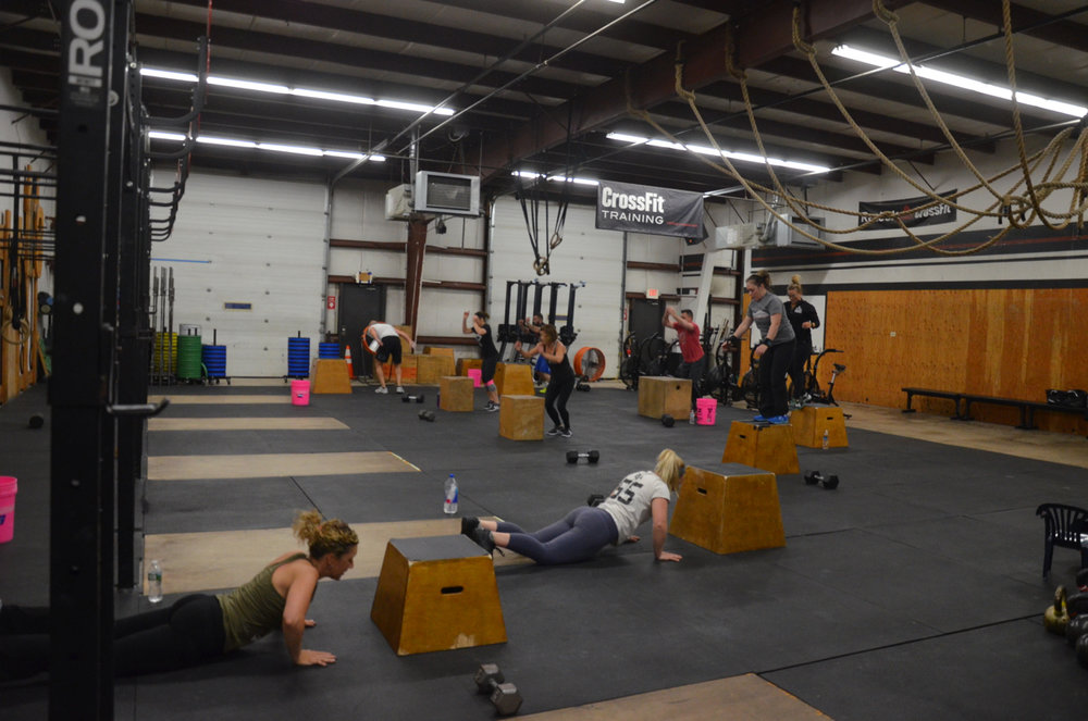 The 4pm class during their first set of burped box jump overs.