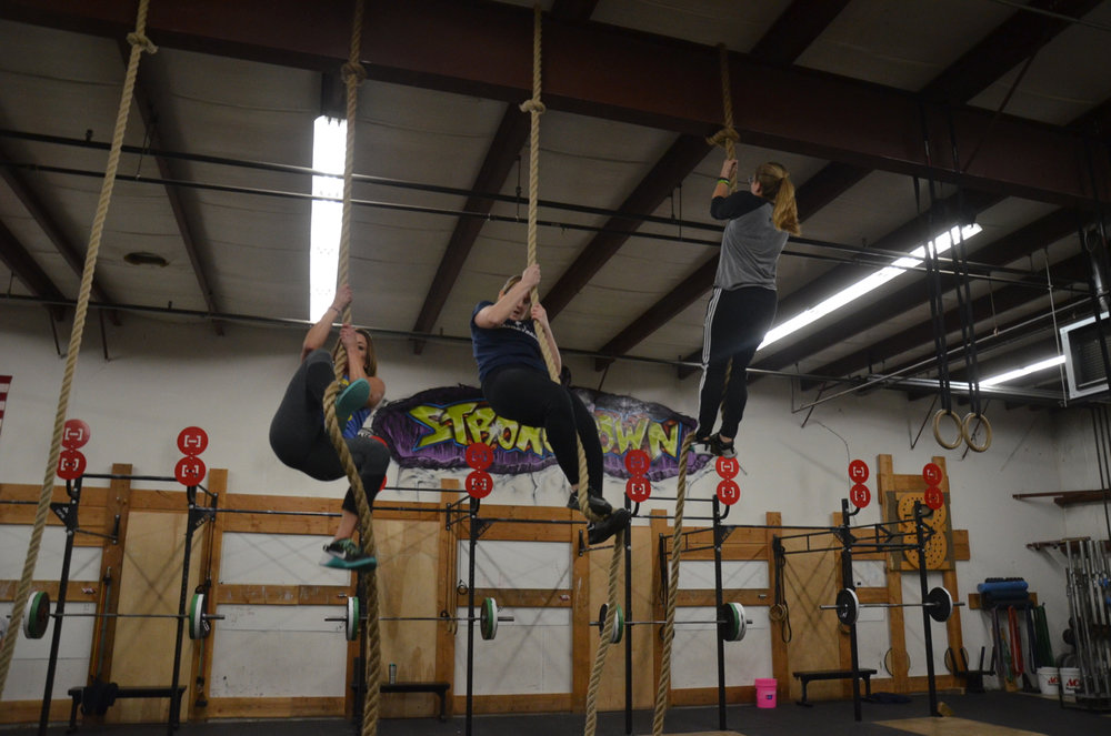 Angela, Becky and Lu working through their rope climbs.
