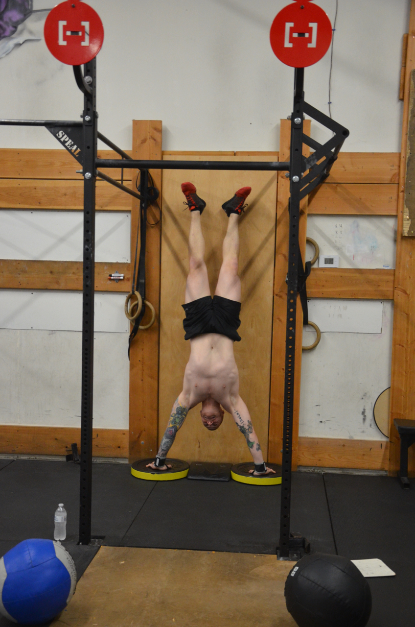 Kevin looking strong on his handstand push-ups.