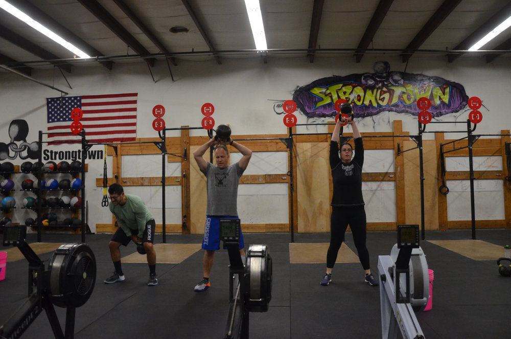 Brad, BVN and Maegan during their Kettlebell swings.