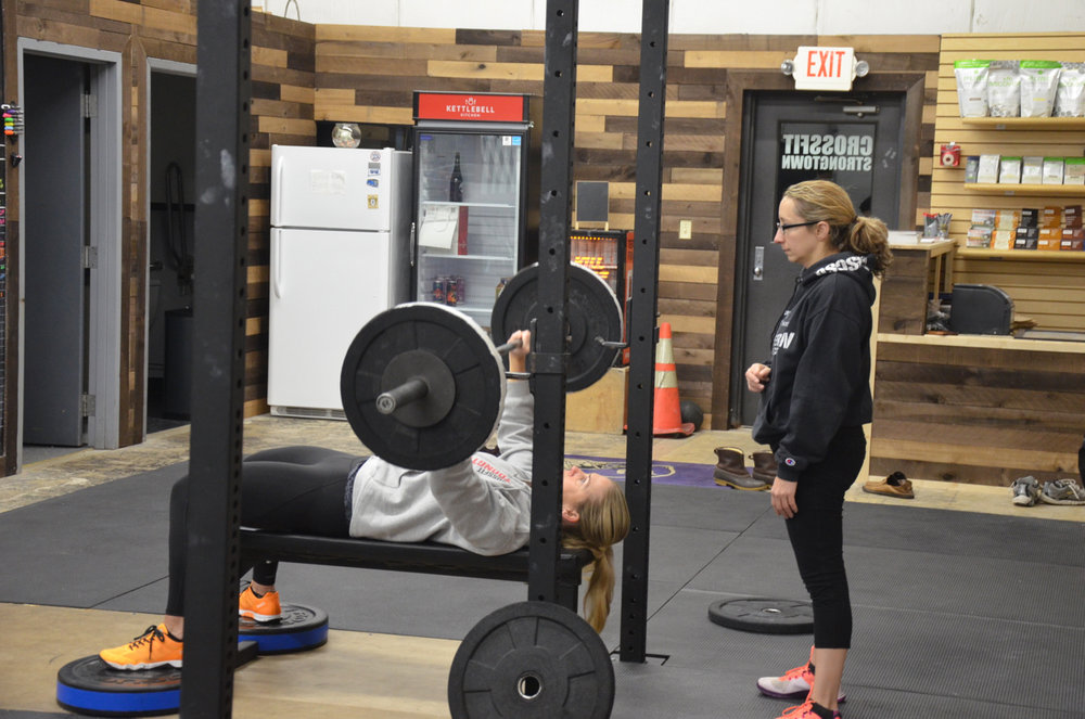 Annette spotting Ro during her 5x5 Bench Press.