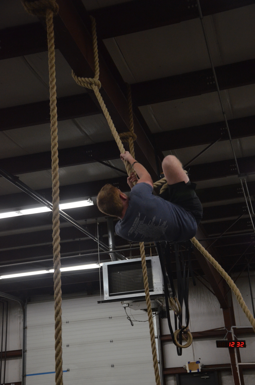 Chris making sure to bring his knees up high on the rope climbs.